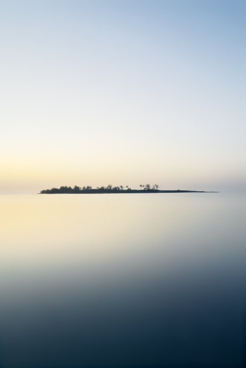 long exposure photography island smooth ocean