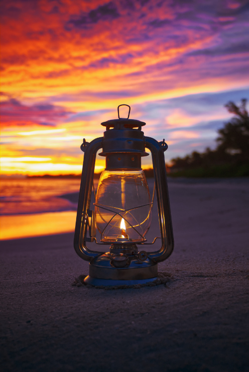 lantern beach golden hour darkness light nature wonder searching meaning