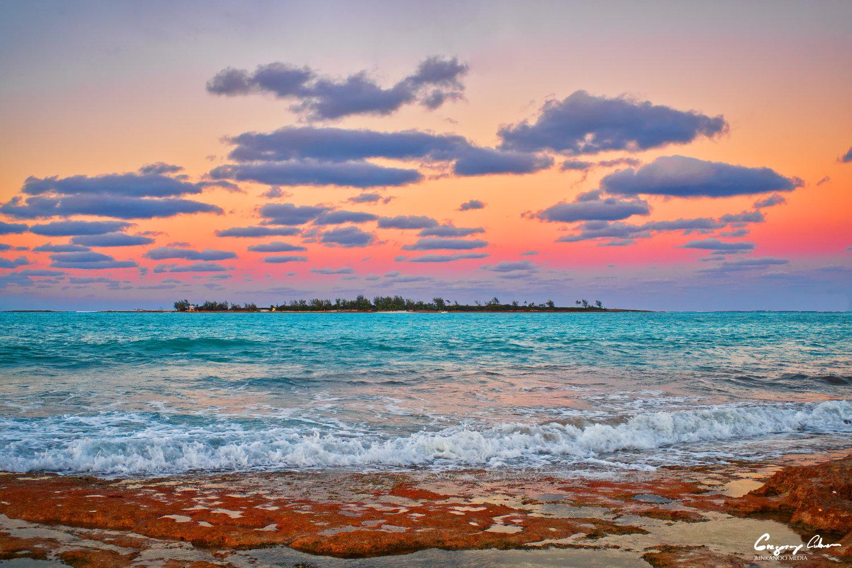 island sunset ocean rocks